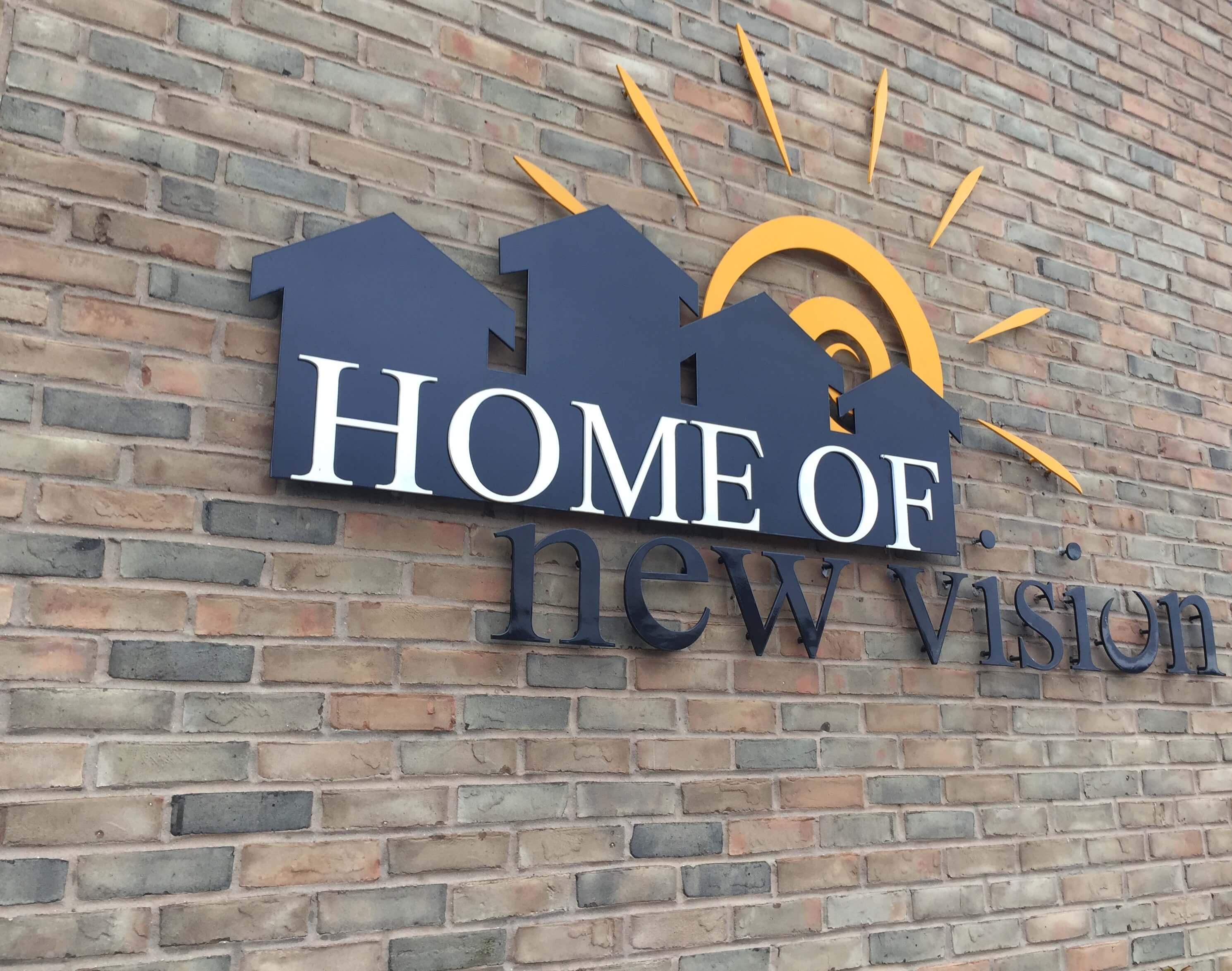 Home of new vision logo on the side of the building