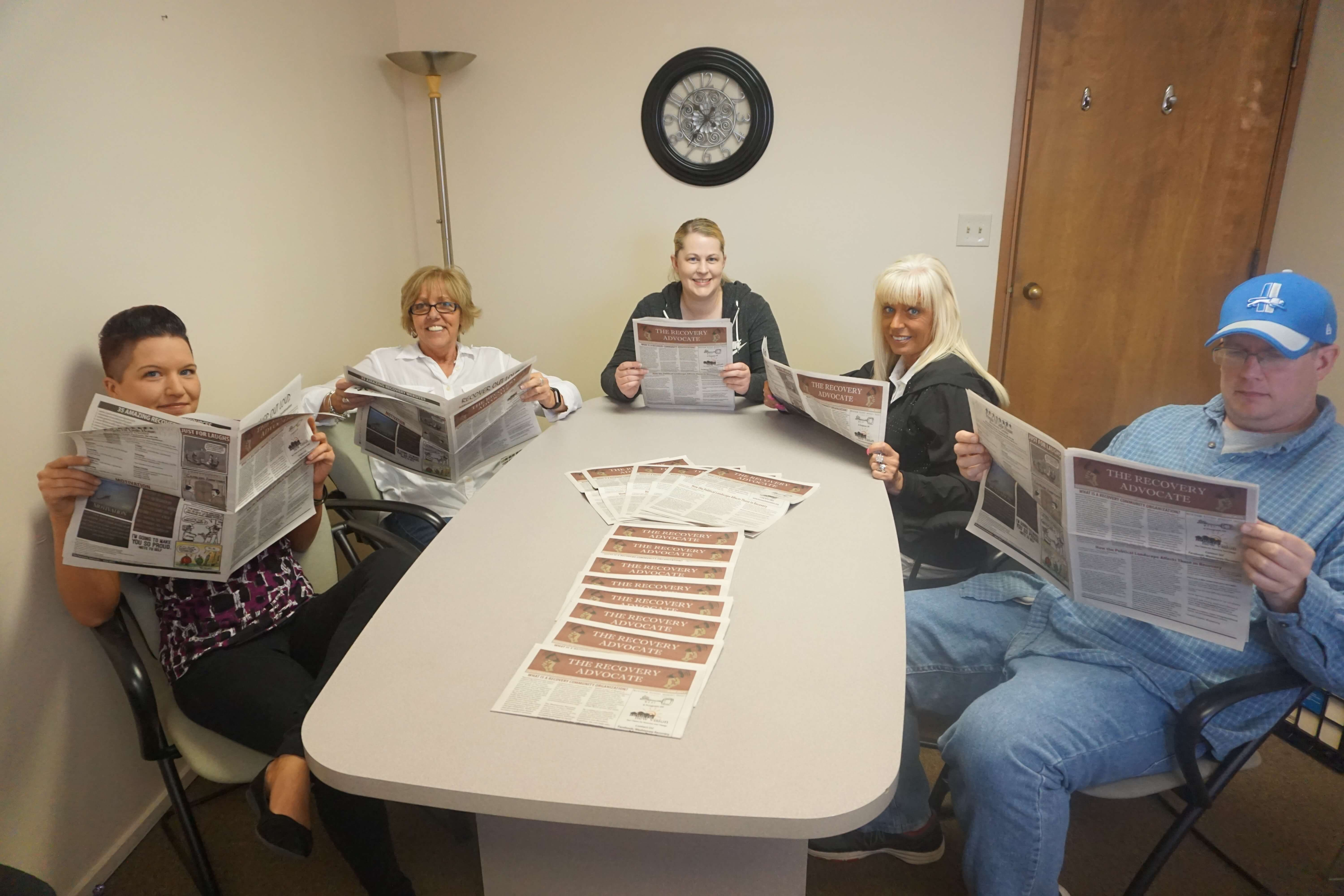 Staff Reading The Recovery Advocate